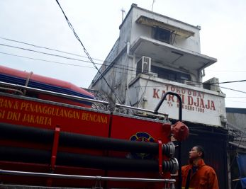 A fire truck in front of the historical shop Kartika Djaja or Fuk Sen Tong