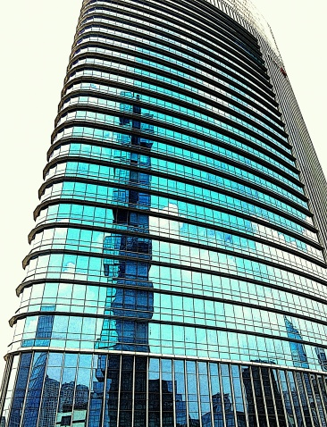A reflection of Thamrin Nine from the City Tower.