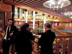 "Cruise staff seemed leisuring in the glitzy lobby. ""Cruising in Italian Style"" makes them able to mix professional on-duty hours with relaxing attitude."